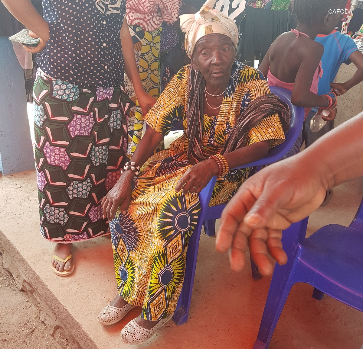 An elderly woman targeted as a privileged beneficiary attending the closed goods fair for displaced in Beni. Photo credit: CAFOD